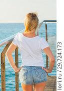 Купить «Female is posing on pirce in her free time», фото № 29724173, снято 17 июля 2017 г. (c) Яков Филимонов / Фотобанк Лори
