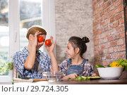 Купить «Mom and daughter cook together at home», фото № 29724305, снято 24 декабря 2018 г. (c) Типляшина Евгения / Фотобанк Лори