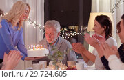 Купить «happy family having birthday party at home», видеоролик № 29724605, снято 7 января 2019 г. (c) Syda Productions / Фотобанк Лори