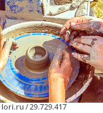 Купить «Learning pottery, the hands of the potter direct the student's hands and help him when working on the potter's wheel», фото № 29729417, снято 10 августа 2018 г. (c) Акиньшин Владимир / Фотобанк Лори