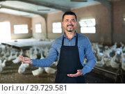 Купить «Farmer among gooses on farm», фото № 29729581, снято 23 января 2019 г. (c) Яков Филимонов / Фотобанк Лори