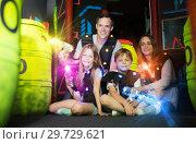 Купить «Kids and adults in beams on lasertag arena», фото № 29729621, снято 6 июня 2018 г. (c) Яков Филимонов / Фотобанк Лори