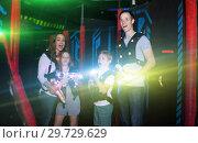 Купить «Kids and parents in beams during laser tag game», фото № 29729629, снято 6 июня 2018 г. (c) Яков Филимонов / Фотобанк Лори
