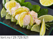 Купить «Delicious ceviche from cod on a glass plate with lime and greens», фото № 29729921, снято 17 января 2019 г. (c) Яков Филимонов / Фотобанк Лори