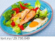 Купить «Cooked egg with fried trout, vegetables and fresh lettuce at plate on table», фото № 29730049, снято 17 января 2019 г. (c) Яков Филимонов / Фотобанк Лори