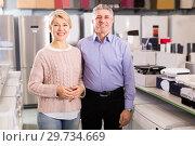 Купить «Married adults are visiting shop of household appliances for buy», фото № 29734669, снято 22 августа 2019 г. (c) Яков Филимонов / Фотобанк Лори