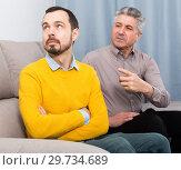 Купить «Adult father and son solve problems», фото № 29734689, снято 18 июня 2019 г. (c) Яков Филимонов / Фотобанк Лори