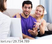 Young couple meeting financial adviser at home. Стоковое фото, фотограф Яков Филимонов / Фотобанк Лори