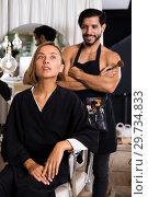 Купить «man makeup artist near client woman», фото № 29734833, снято 19 января 2019 г. (c) Яков Филимонов / Фотобанк Лори