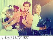 Купить «woman hairdresser and man makeup artist», фото № 29734837, снято 22 августа 2019 г. (c) Яков Филимонов / Фотобанк Лори