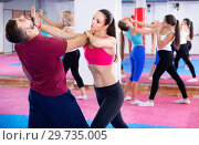 Купить «Sporty girl with her instructor are training self-defence moves in gym.», фото № 29735005, снято 8 октября 2017 г. (c) Яков Филимонов / Фотобанк Лори