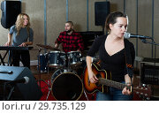 Купить «excited girl rock singer with guitar during rehearsal», фото № 29735129, снято 26 октября 2018 г. (c) Яков Филимонов / Фотобанк Лори