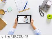 Купить «hands of businesswoman watching webinar on tablet», фото № 29735449, снято 22 марта 2017 г. (c) Syda Productions / Фотобанк Лори