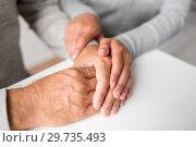 Купить «close up of young woman holding senior man hands», фото № 29735493, снято 7 июля 2016 г. (c) Syda Productions / Фотобанк Лори