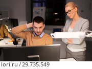 Купить «business team with computer working late at office», фото № 29735549, снято 26 ноября 2017 г. (c) Syda Productions / Фотобанк Лори