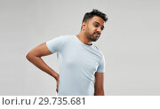 Купить «indian man suffering from backache», фото № 29735681, снято 27 октября 2018 г. (c) Syda Productions / Фотобанк Лори