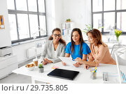 Купить «businesswomen discussing papers at office», фото № 29735805, снято 17 марта 2018 г. (c) Syda Productions / Фотобанк Лори