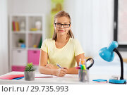 Купить «happy student girl doing homework at home», фото № 29735993, снято 7 октября 2018 г. (c) Syda Productions / Фотобанк Лори