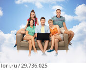 Купить «friends with laptop computer on sofa over clouds», фото № 29736025, снято 30 июня 2018 г. (c) Syda Productions / Фотобанк Лори