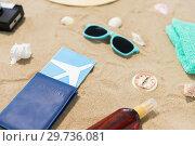 Купить «travel tickets, camera and hat on beach sand», фото № 29736081, снято 27 июня 2018 г. (c) Syda Productions / Фотобанк Лори
