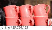 Купить «six stacked cups in trendy living coral color», фото № 29736153, снято 1 декабря 2015 г. (c) Syda Productions / Фотобанк Лори