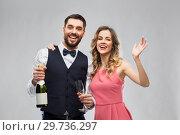 Купить «happy couple with bottle of champagne and glasses», фото № 29736297, снято 30 ноября 2018 г. (c) Syda Productions / Фотобанк Лори
