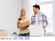 Купить «happy couple with boxes moving to new home», фото № 29736385, снято 25 февраля 2016 г. (c) Syda Productions / Фотобанк Лори