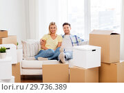 Купить «happy couple with boxes moving to new home», фото № 29736389, снято 25 февраля 2016 г. (c) Syda Productions / Фотобанк Лори