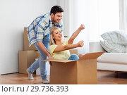 Купить «happy couple having fun with box at new home», фото № 29736393, снято 25 февраля 2016 г. (c) Syda Productions / Фотобанк Лори