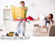 Купить «Husband helping leg injured wife in housework», фото № 29738317, снято 4 октября 2018 г. (c) Elnur / Фотобанк Лори