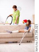 Купить «Husband helping leg injured wife in housework», фото № 29738321, снято 4 октября 2018 г. (c) Elnur / Фотобанк Лори