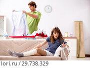 Купить «Husband helping leg injured wife in housework», фото № 29738329, снято 4 октября 2018 г. (c) Elnur / Фотобанк Лори