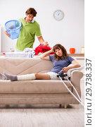 Купить «Husband helping leg injured wife in housework», фото № 29738337, снято 4 октября 2018 г. (c) Elnur / Фотобанк Лори