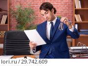 Купить «Young handsome lawyer working in his office», фото № 29742609, снято 10 сентября 2018 г. (c) Elnur / Фотобанк Лори