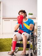 Купить «Injured man recovering from his injury», фото № 29743653, снято 21 сентября 2018 г. (c) Elnur / Фотобанк Лори