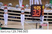Купить «KAZAN, RUSSIA 23-12-18: Women in white costumes dancing for team supporting. Sports shot clock countdown.», видеоролик № 29744065, снято 23 июля 2019 г. (c) Константин Шишкин / Фотобанк Лори