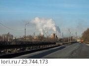 Купить «Industrial landscape with metallurgical plant, fuming pipes and white smoke. Metallurgical works with smoke. Industrial architecture.», фото № 29744173, снято 31 января 2018 г. (c) Евгений Бобков / Фотобанк Лори