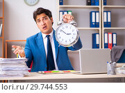 Купить «Young handsome businessman working in the office», фото № 29744553, снято 10 августа 2018 г. (c) Elnur / Фотобанк Лори
