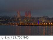 Купить «Пламенные башни в ночном городском пейзаже. Баку», фото № 29750845, снято 4 января 2018 г. (c) Виктор Карасев / Фотобанк Лори
