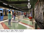Купить «Passengers at Kungstradgarden, station of Stockholm metro», фото № 29751537, снято 9 июля 2018 г. (c) Валерия Попова / Фотобанк Лори