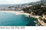 Купить «Picturesque aerial view of Mediterranean coastal town of Lloret de Mar in Catalonia, Spain», видеоролик № 29752309, снято 11 июня 2018 г. (c) Яков Филимонов / Фотобанк Лори