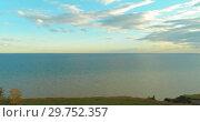 Купить «Aerial hyperlapse of sunset and clouds above sea coast. Timelapse drone fly near ocean bank. High speed horizontal moving.», видеоролик № 29752357, снято 24 сентября 2018 г. (c) Александр Маркин / Фотобанк Лори