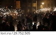 Купить «Traditional Correfoc and costumed devils procession during festivities on La Merce festival», видеоролик № 29752505, снято 22 сентября 2018 г. (c) Яков Филимонов / Фотобанк Лори