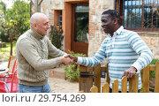 Купить «Friendly farmers shaking hands», фото № 29754269, снято 15 декабря 2018 г. (c) Яков Филимонов / Фотобанк Лори