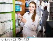 Купить «Two pharmacists in chemist shop», фото № 29754453, снято 17 октября 2019 г. (c) Яков Филимонов / Фотобанк Лори
