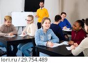 Classmates working in groups. Стоковое фото, фотограф Яков Филимонов / Фотобанк Лори