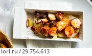 Купить «Pulpo a la Gallega (Galician octopus)», фото № 29754613, снято 28 ноября 2018 г. (c) Яков Филимонов / Фотобанк Лори