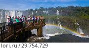 Купить «Tourists on waterfall Cataratas del Iguazu, Brazil», фото № 29754729, снято 17 февраля 2017 г. (c) Яков Филимонов / Фотобанк Лори