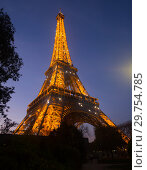 Купить «Night view of Eiffel Tower on sunset», фото № 29754785, снято 9 октября 2018 г. (c) Яков Филимонов / Фотобанк Лори