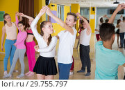 Купить «Children dancing rock-and-roll in pairs», фото № 29755797, снято 3 марта 2018 г. (c) Яков Филимонов / Фотобанк Лори
